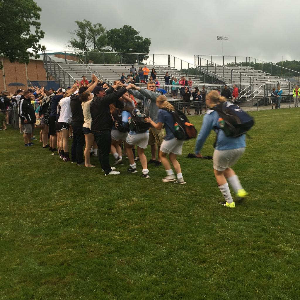 Loy Norrix students welcome the District Champs off the field