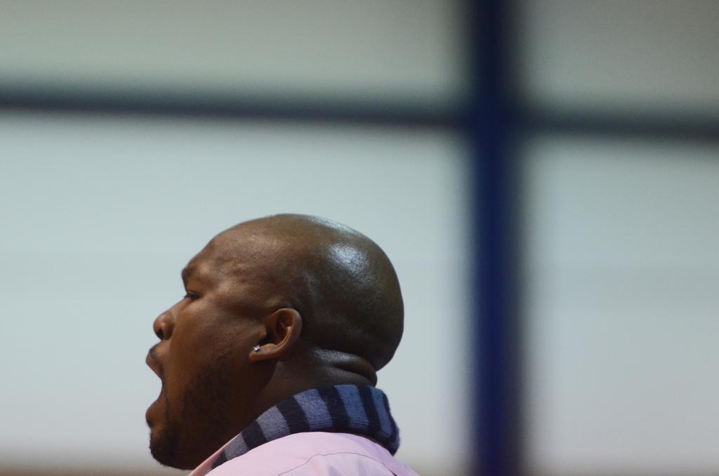 Coach Kenyada Dent helps Flint Hamady hit century mark