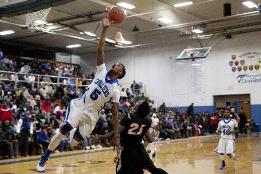 Flint Carman-Ainsworth in 'shock, awe' after dominating Saginaw High, 80-51, in Class A boys basketball regionals