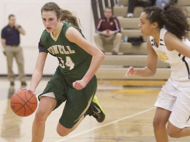 Erin Honkala drives to the basket