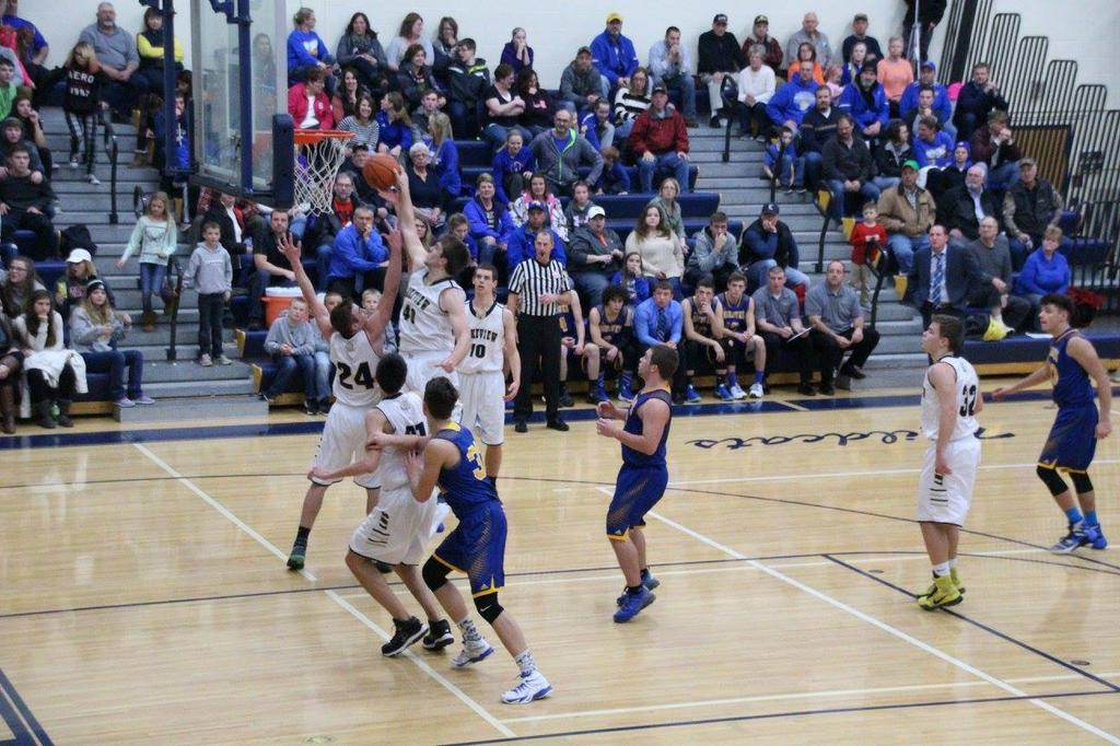 Senior Trevor Arnold blocks a shot.  Trevor had two blocked shots and ten rebounds in the win over the Mohawks.