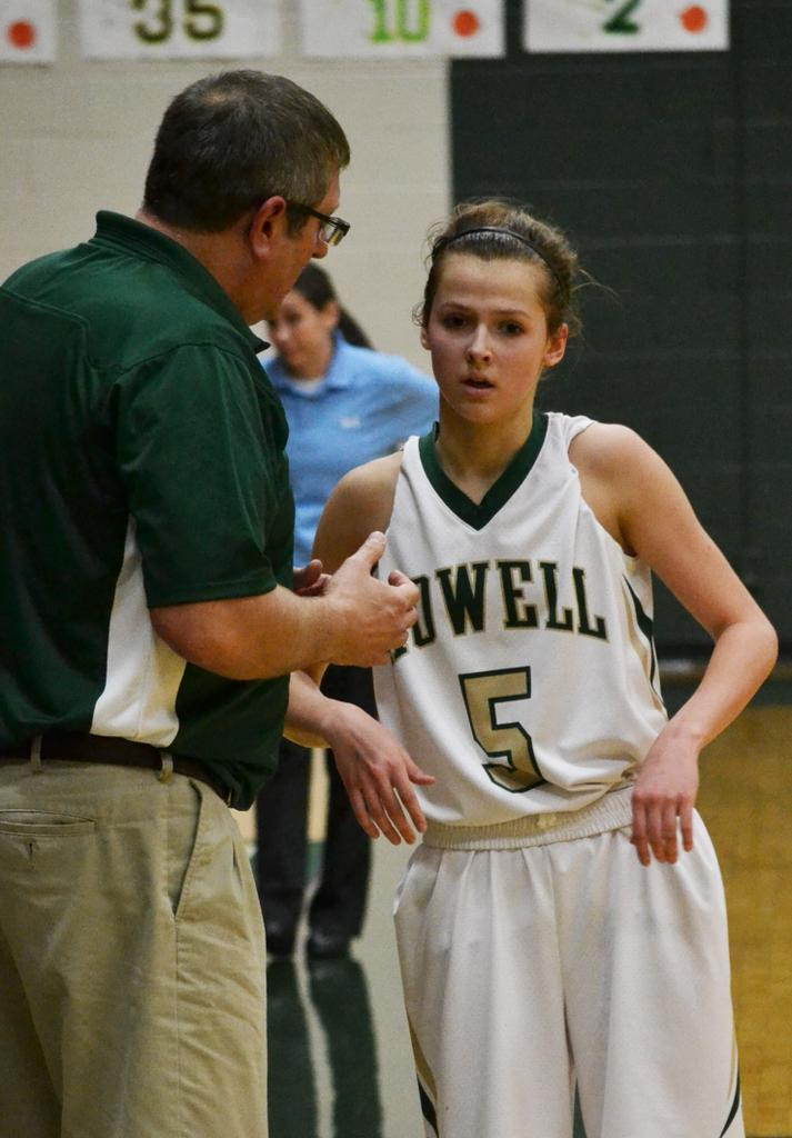 Coach Tim Olszewski talks with Sophomore guard Alexis Miller in a recent contest