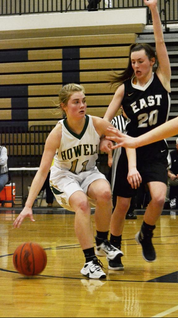 Howell's, Paige Johnson, surveys the floor in the second half of Wednesday's district semifinal game. Howell defeated South Lyon East, 52-39.