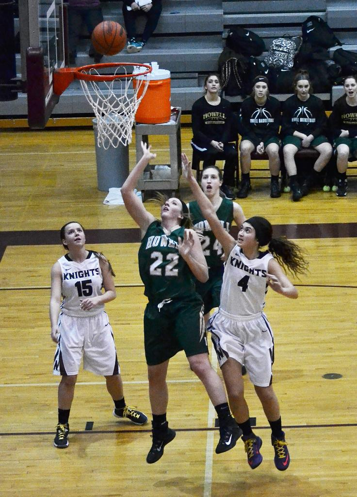 Howell's, Brittney Resinger, attacks the basket in the 2nd half of Howell's 60-20 victory at Walled Lake Northern
