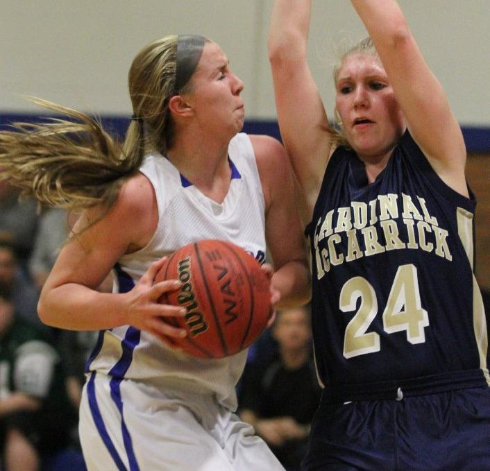 Cassie Smith of Metuchen (left) was second in the state with 31.3 points per game. (Mary Iuvone/For the Star Ledger)