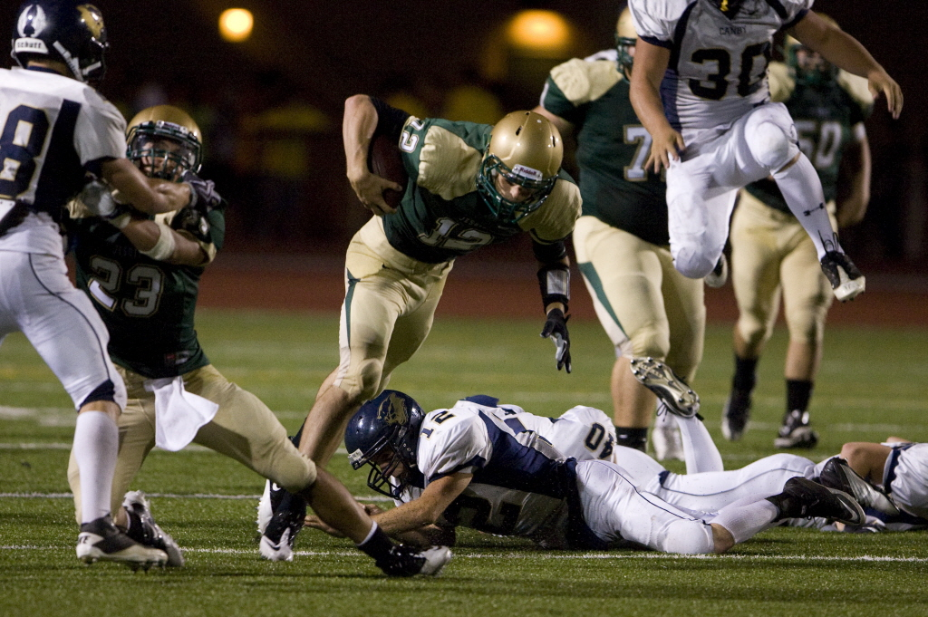 Crusaders put pedal to metal early, stop Canby 34-14