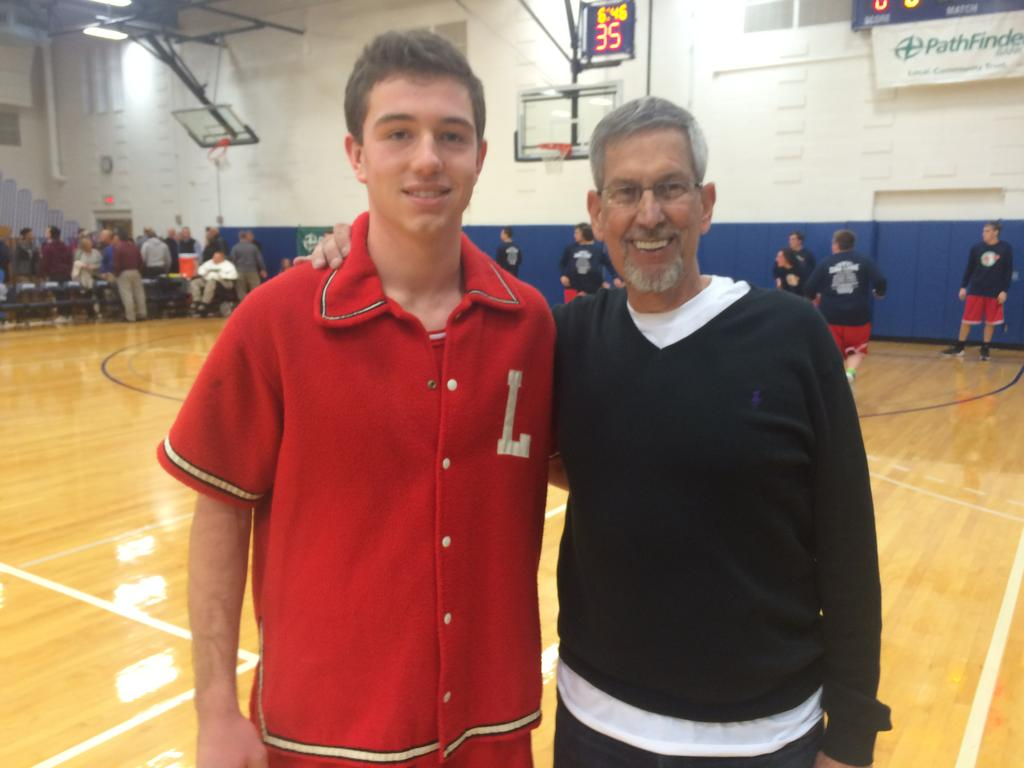Ryan Agedal (left) of LaFayette wears the old 1973 St. Lucy's warm up jacket of Dick Strom (right).