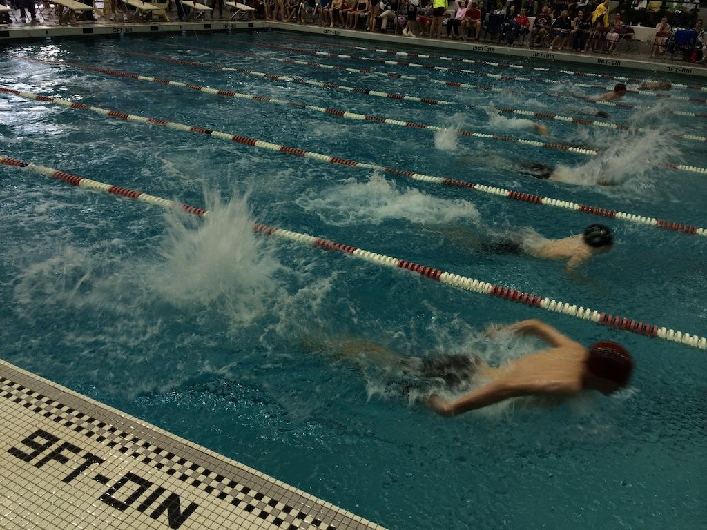 Hawken boys and girls swimming both win chagrin valley conference invitational for Cleveland high school swimming pool