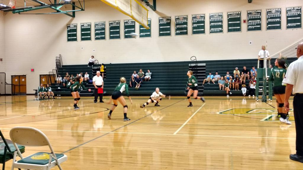 Hannah Egeler gets down low for one of her 8 Digs.