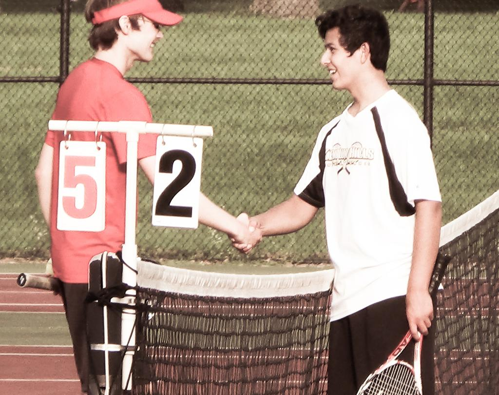 A great match between friendly rivals ends in smiles