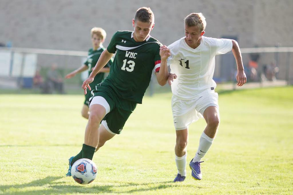 Chance Larson battles a GRCC attacker for the ball.