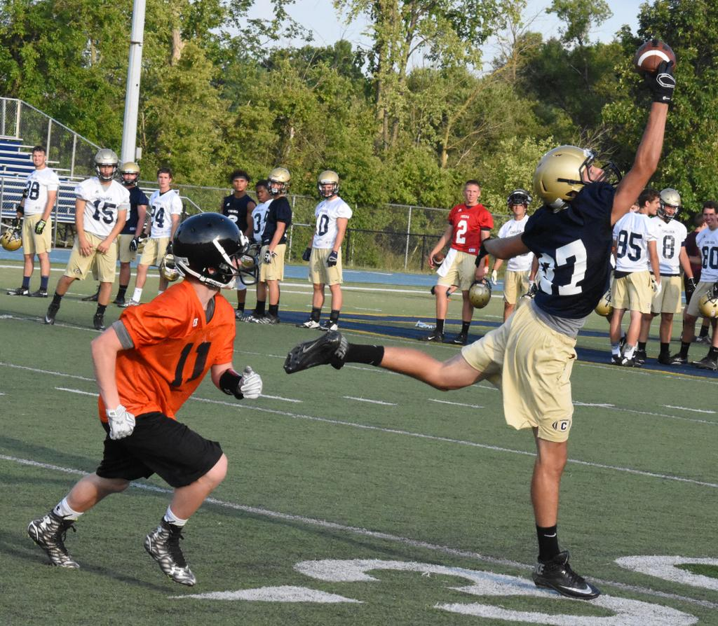 Junior jared hansen leaps for a one handed highlight reel catch al wright