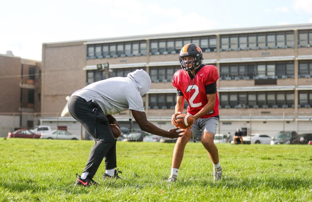4fe90e4b6 Nick Kargman works with Wilson coach Preston Brown during practice. (Andrew  Mills