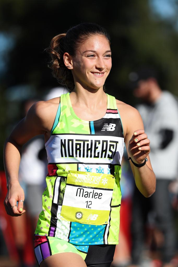 055cb8732 Northern junior Marlee Starliper smiles during the early going at  Saturday s Foot Locker cross country championships in San Diego.